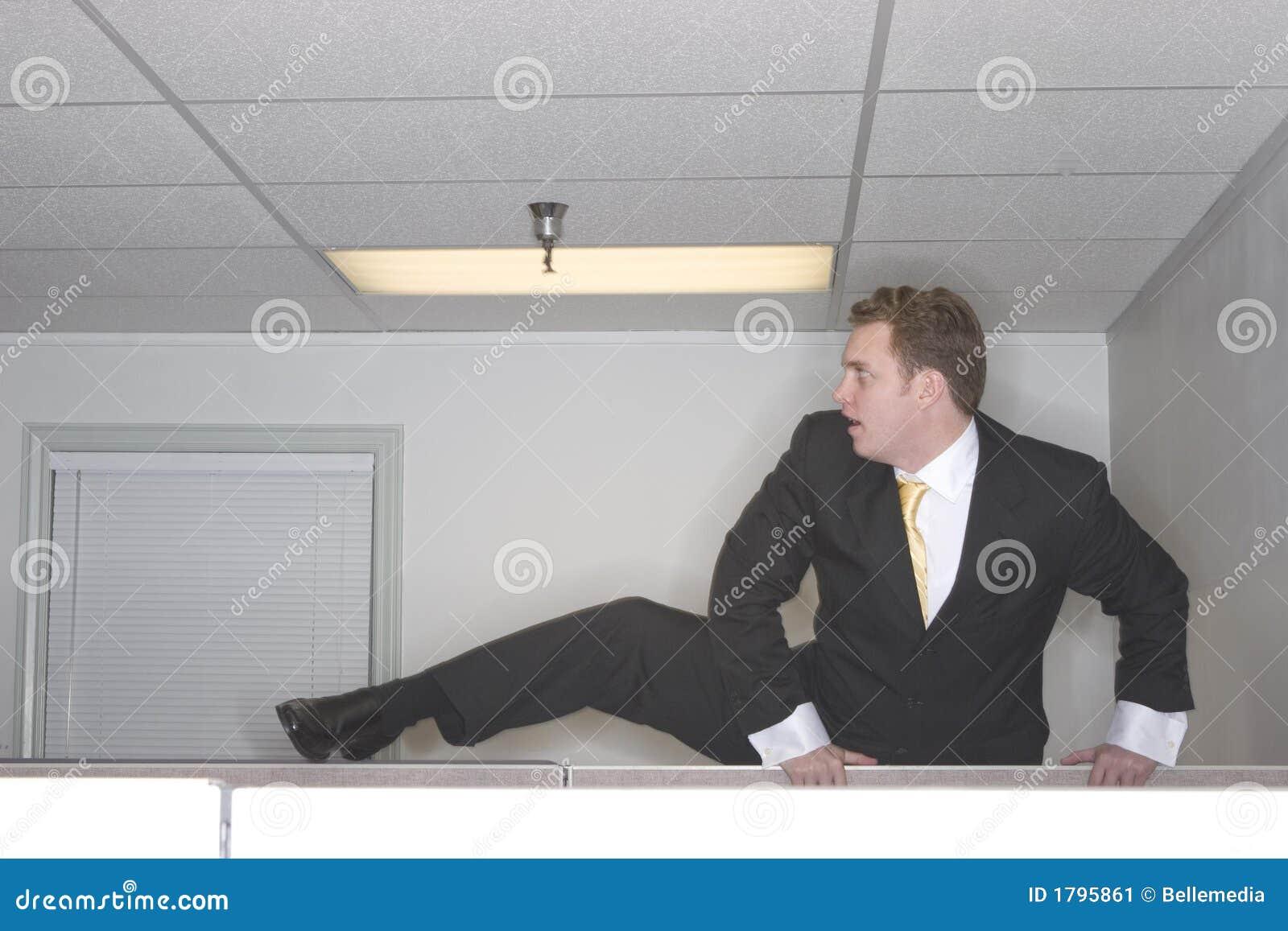 Businessman climbs cubicl over