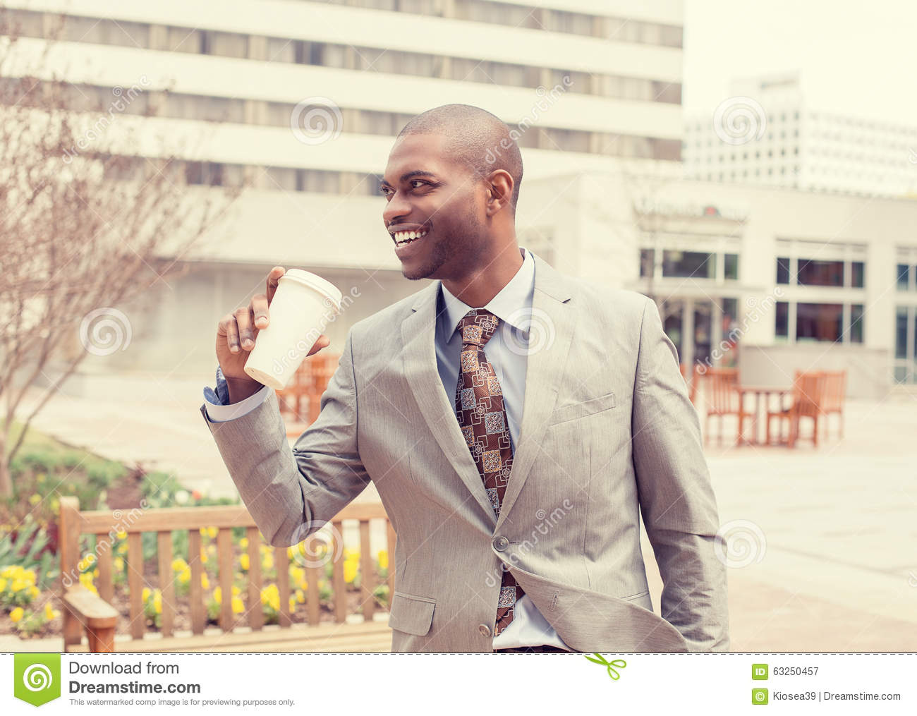 Businessman with coffee going to work
