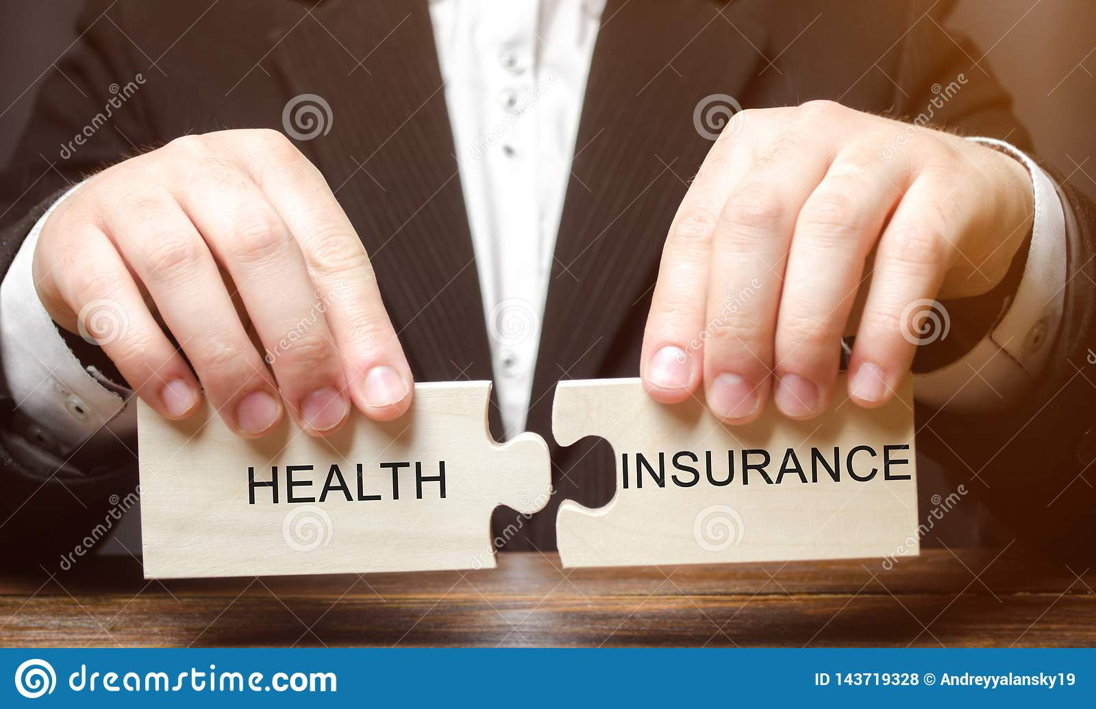 Businessman collects wooden blocks with the word Health insurance. Health care concept. Cash costs for medical care. Financial