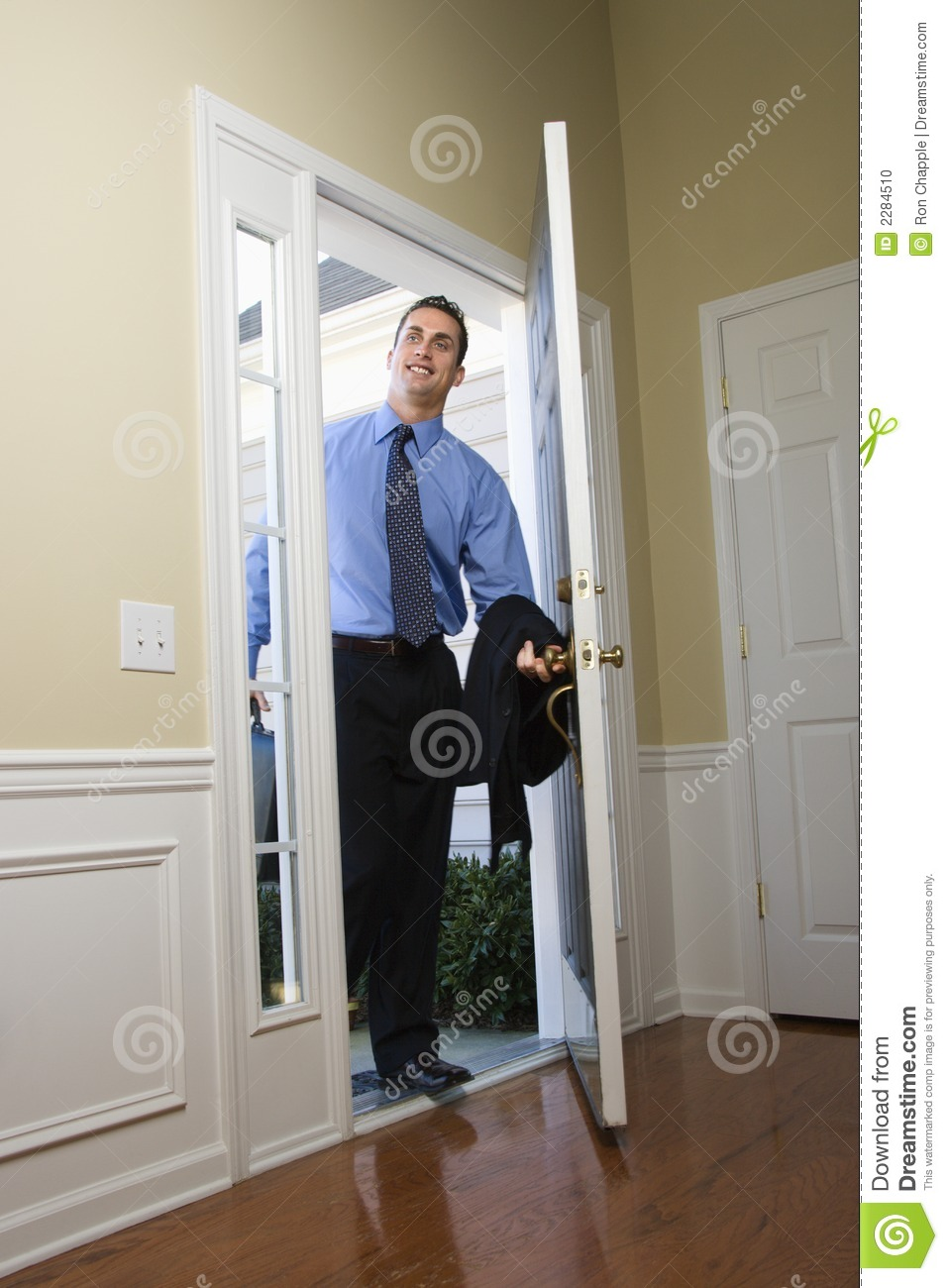 Businessman coming home