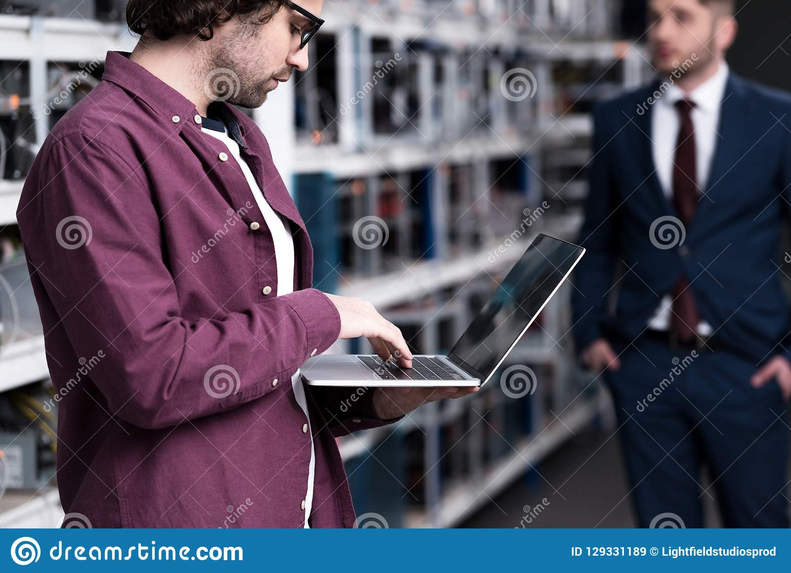 Businessman and computer engineer at ethereum mining farm royalty free stock images