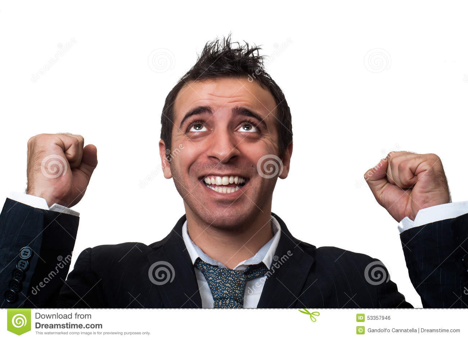 Businessman in dark suit fists raised looking up