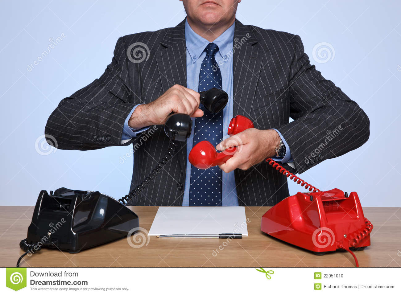 Businessman At Desk On A Conference Call. Stock Photo - Image