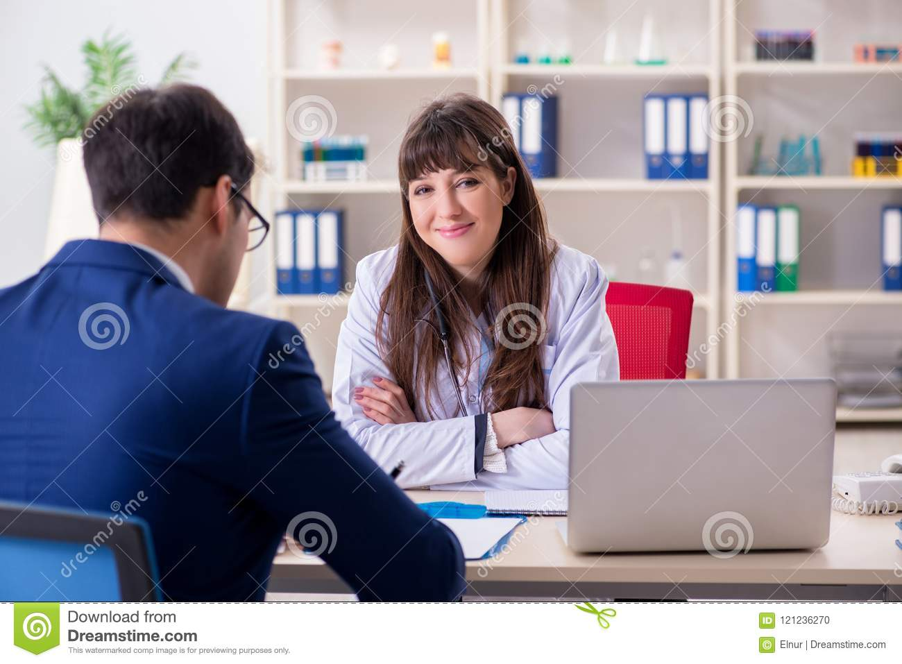 The businessman discussing health issues with doctor