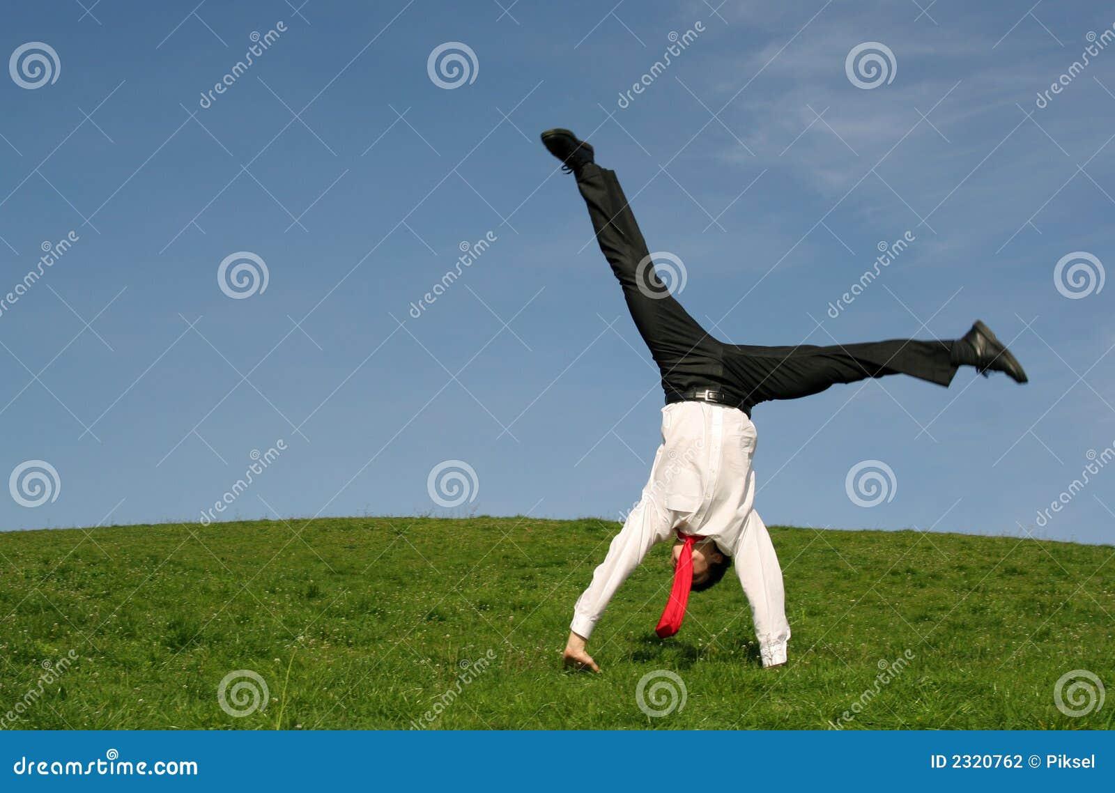 Businessman doing cartwheel