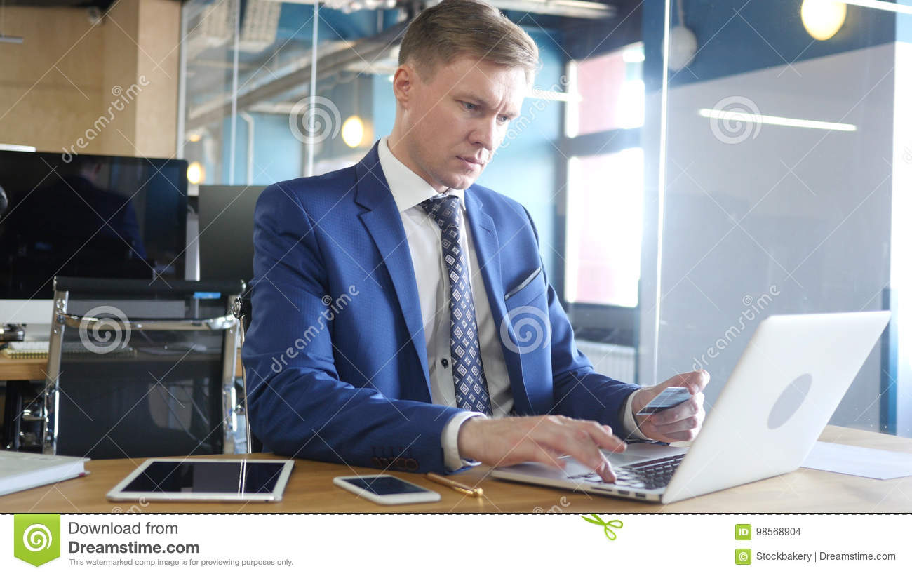 Businessman doing online shopping with credit card