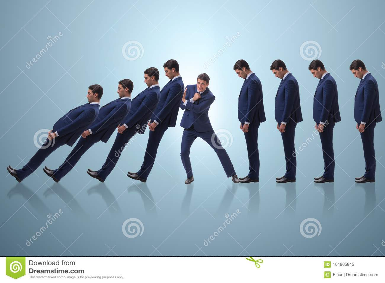 The businessman in domino effect business concept