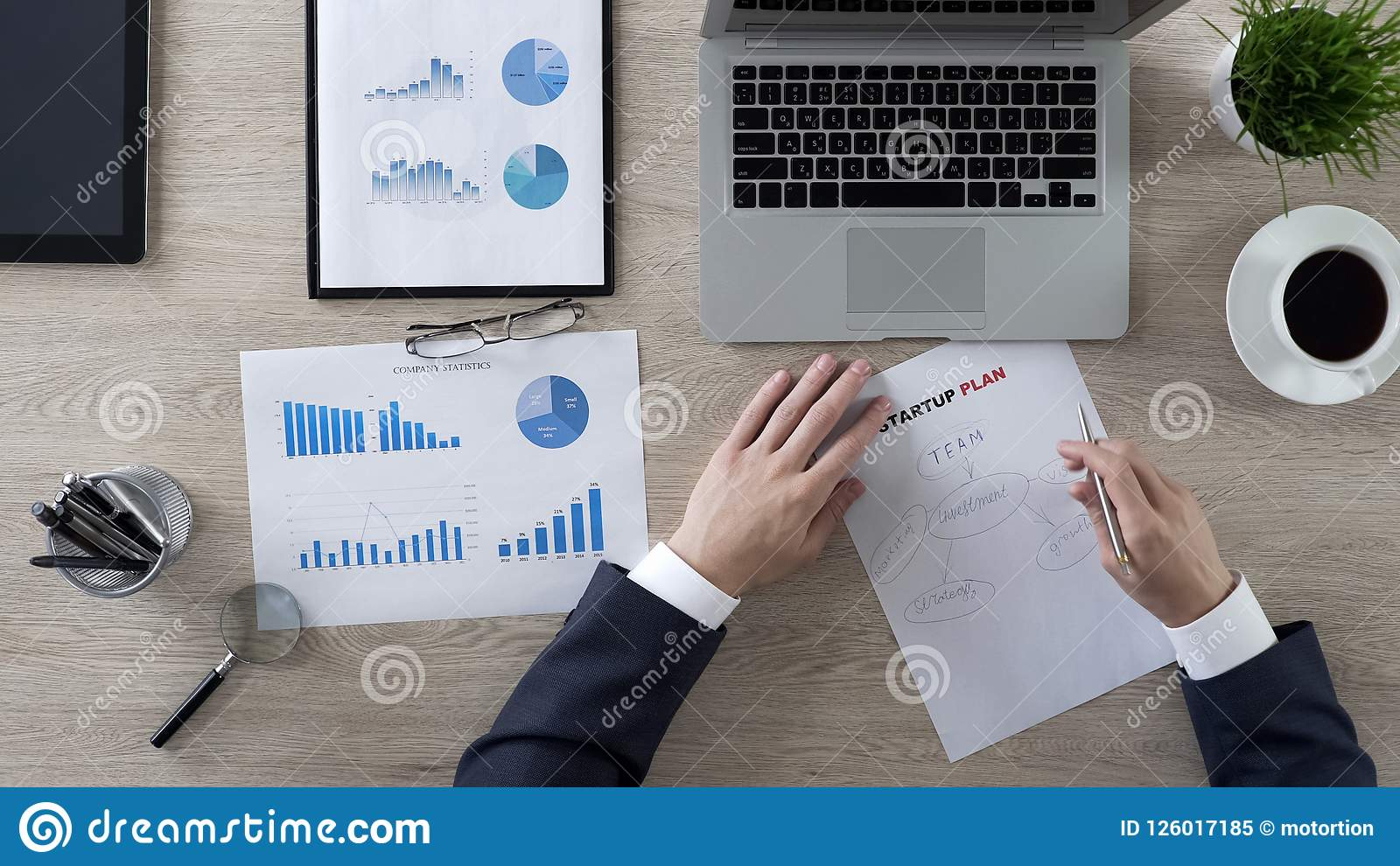 Businessman drawing components of startup plan, brainstorm and ideas, top view