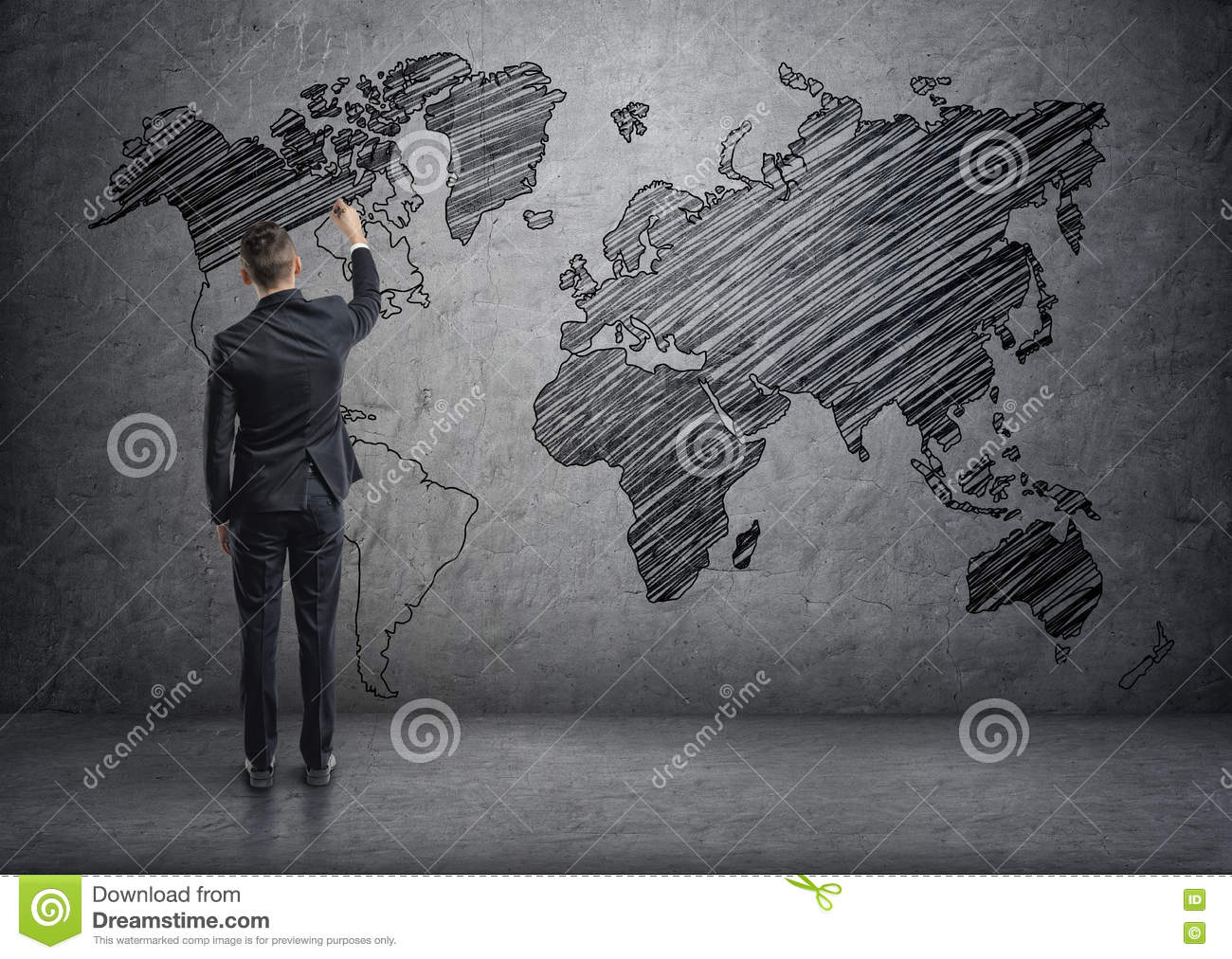 Businessman drawing world map on the concrete wall stock businessman drawing world map on the concrete wall gumiabroncs Choice Image