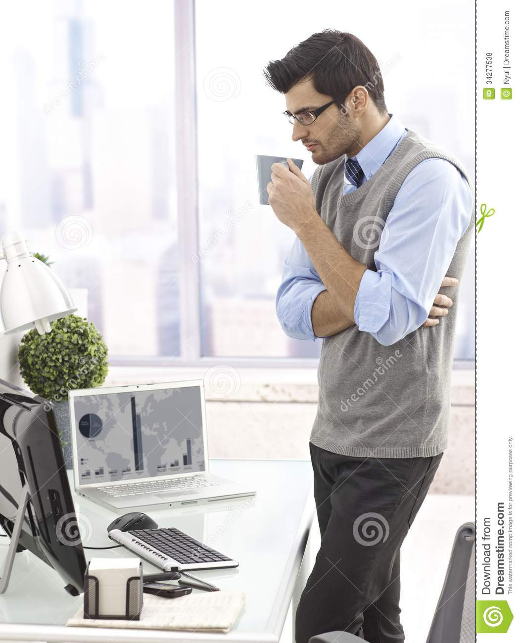 Businessman Drinking Coffee Standing In Office Royalty Free Stock Photos - Image: 34277538