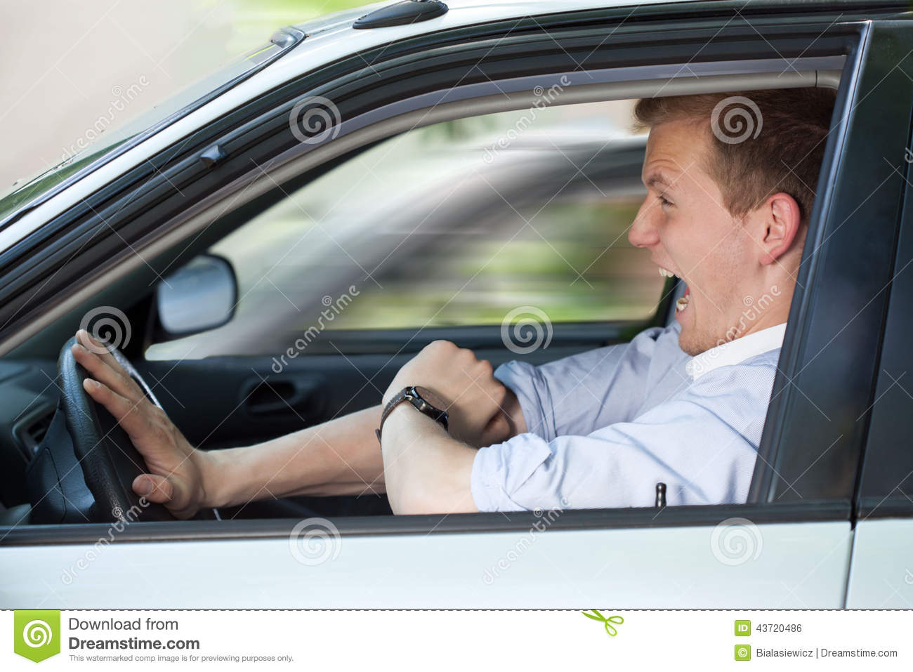 Businessman driving fast his car