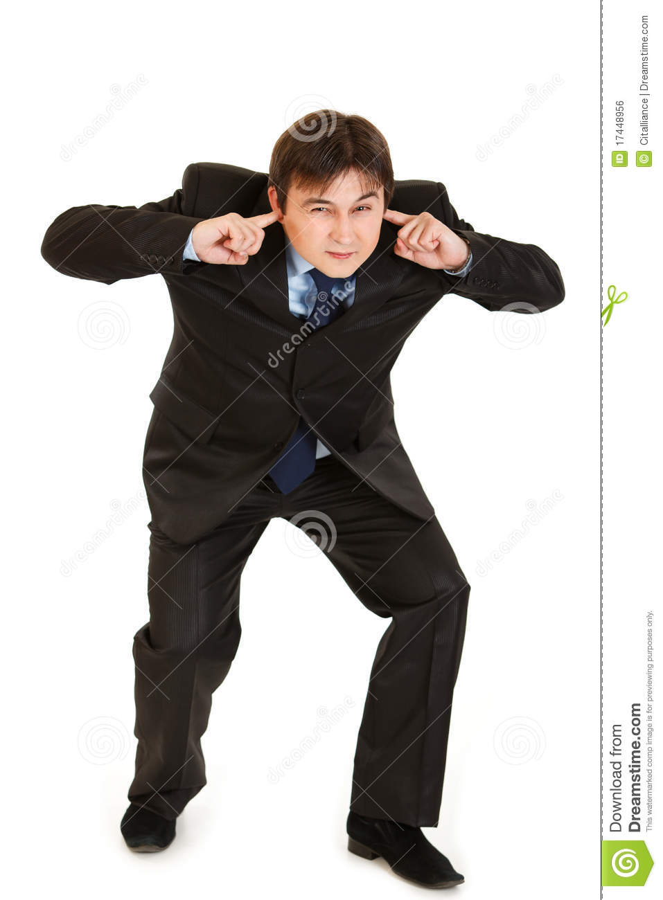 Businessman ducking in fear and closing ears