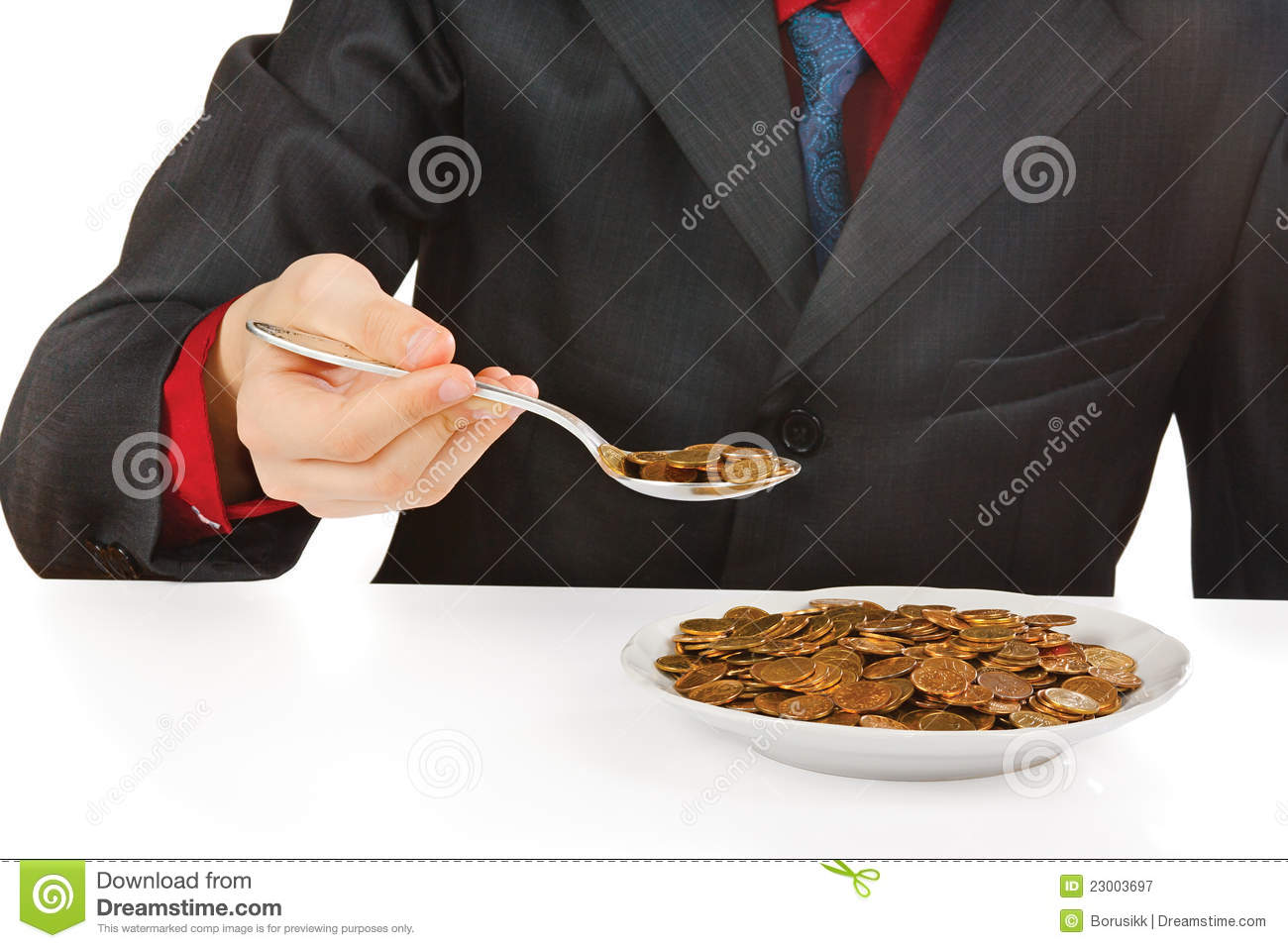 Businessman eating money