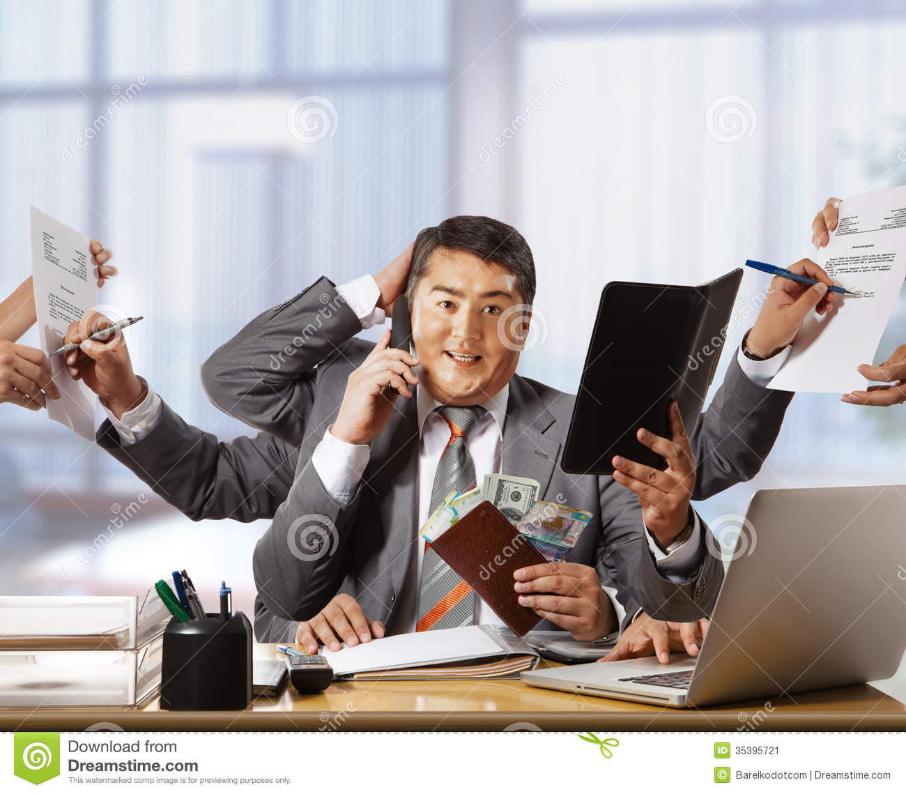 Technology Management Image: Businessman With Eight Hands In Elegant Suit Working Hold