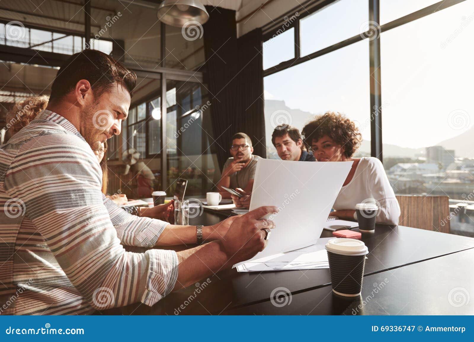 Businessman explaining business plan to his colleagues