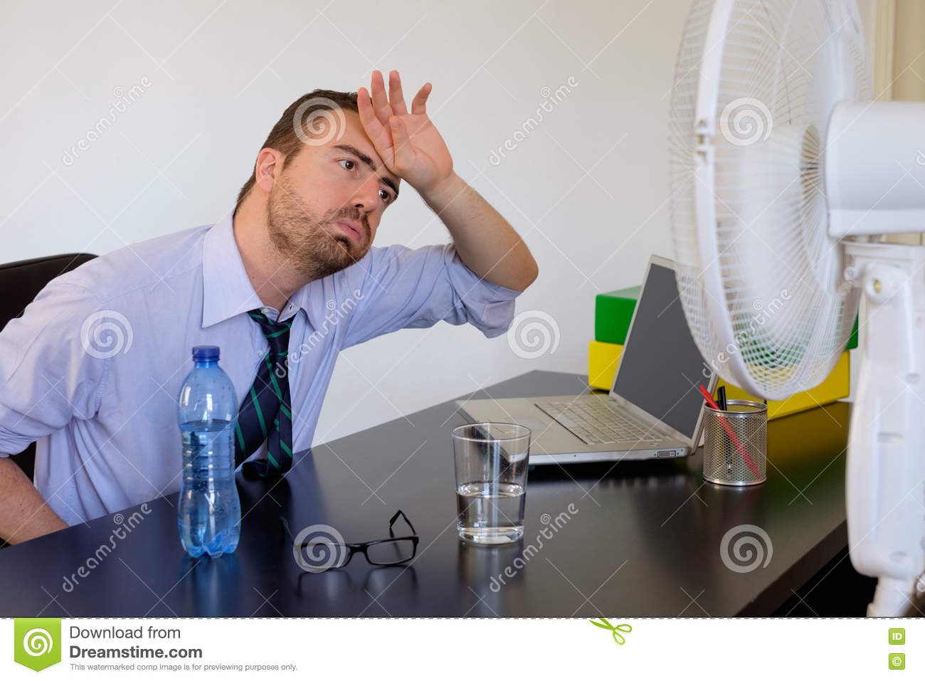 Businessman Feeling Hot In The Office Stock Photo Image 75677194