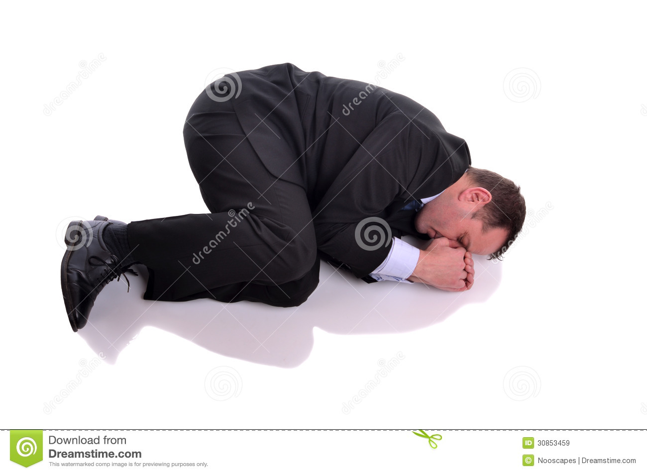 Businessman In Fetal Position Royalty Free Stock Images