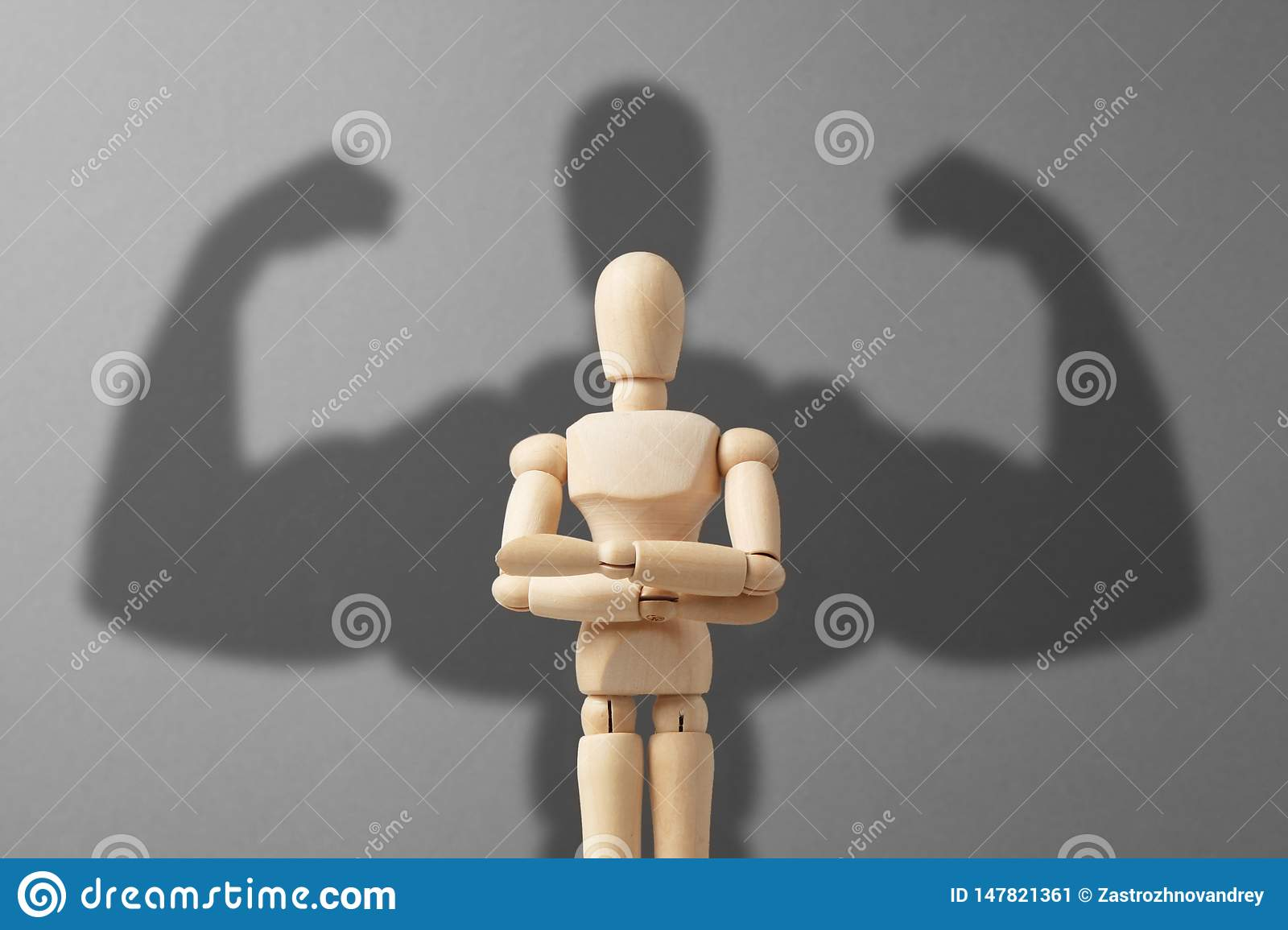 Businessman figure with strong shadow. Concept of power in business
