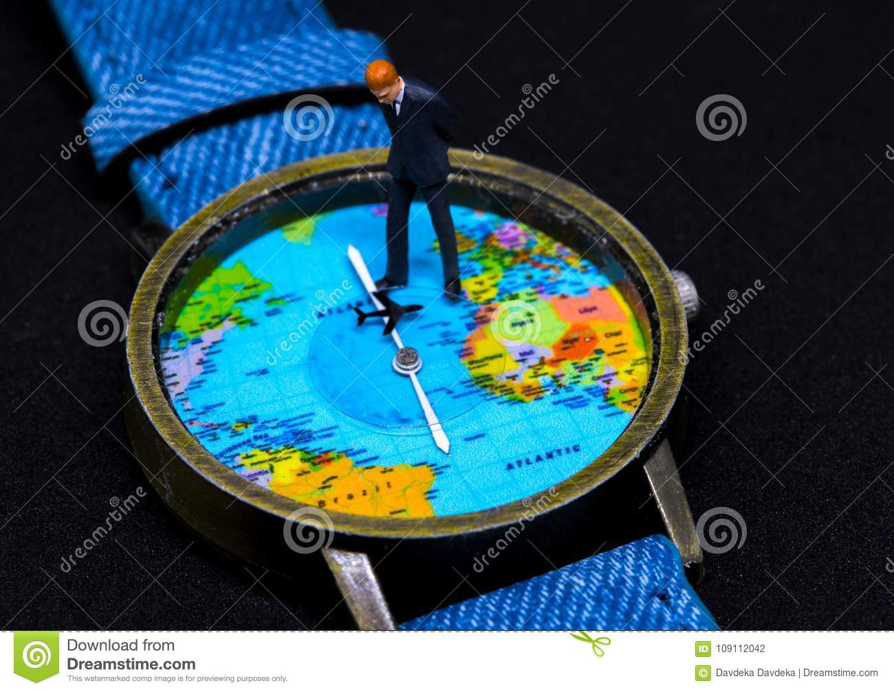 Businessman figurine on watch world map clock worldwide business download businessman figurine on watch world map clock worldwide business concept stock photo gumiabroncs Images