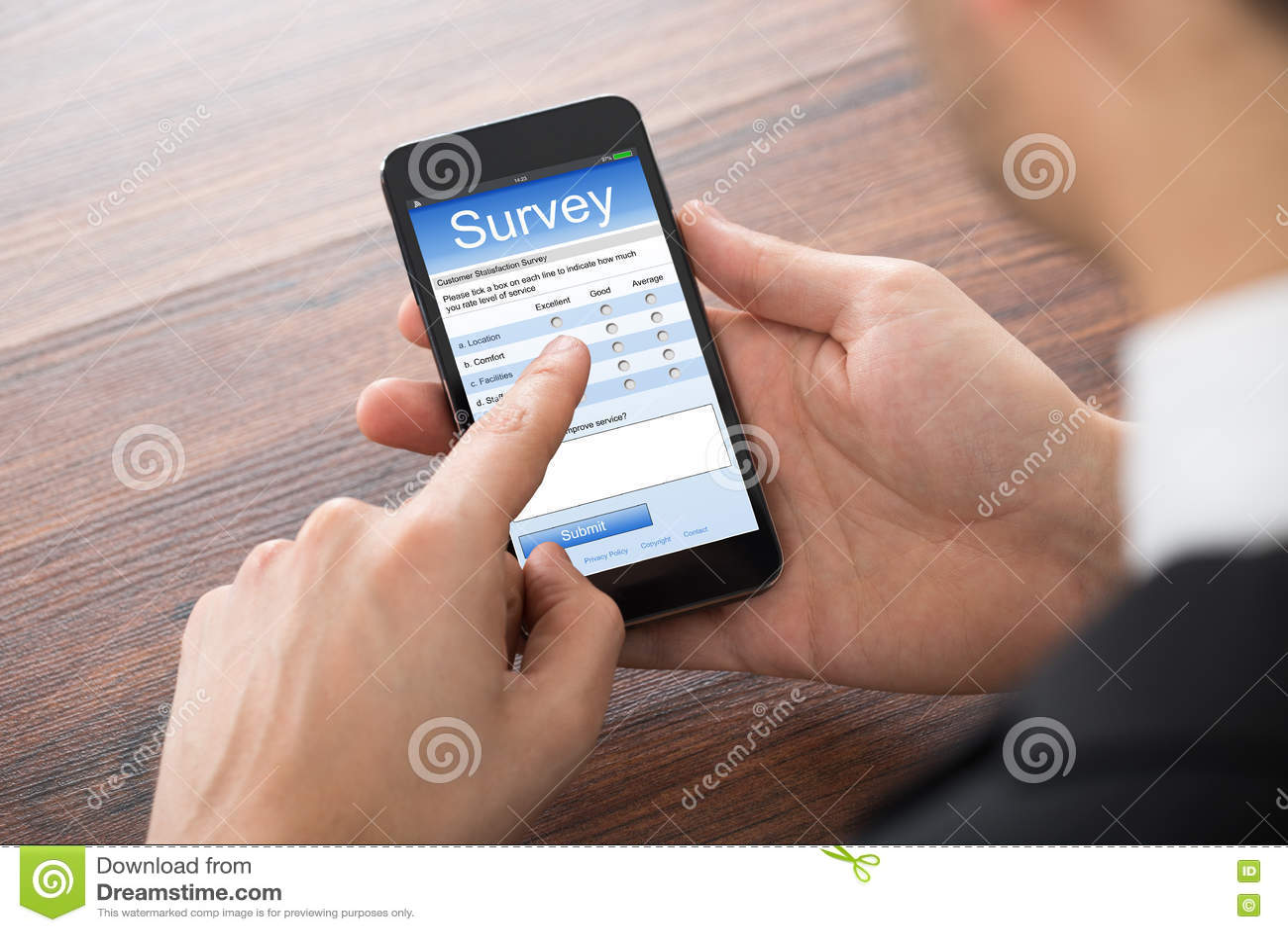 businessman filling survey form stock photo 54642816. Black Bedroom Furniture Sets. Home Design Ideas