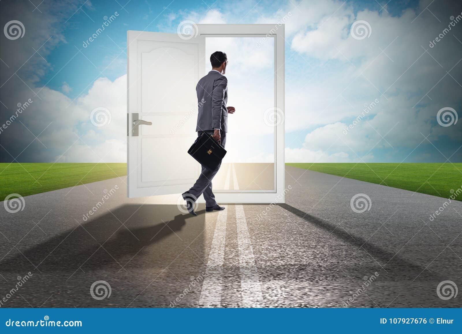 The businessman in front of door in business opportunities concept