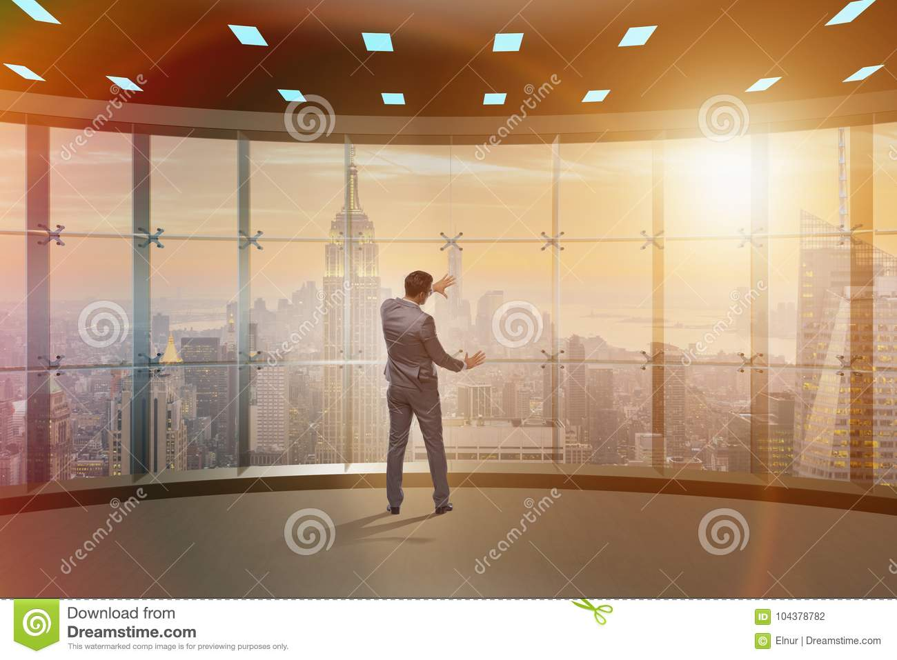 The businessman in front of office window thinking of new challenges