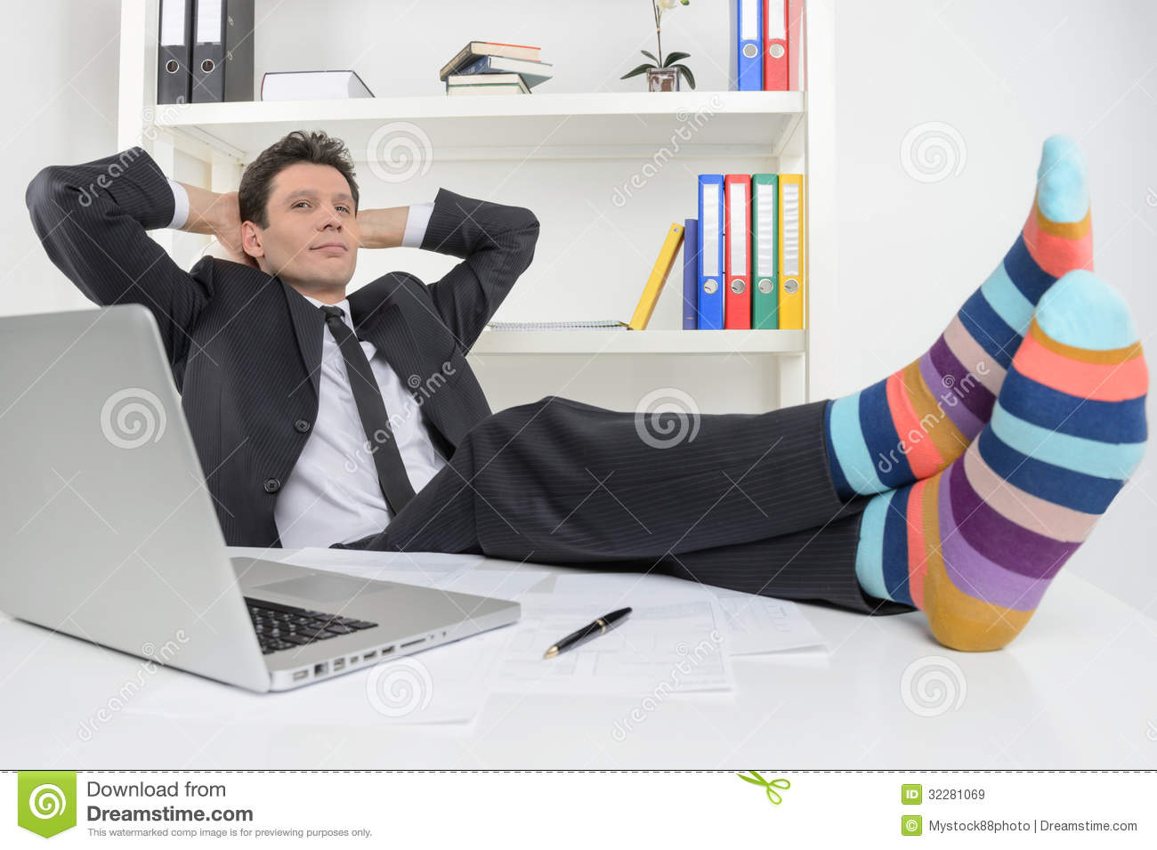 Businessman In Funky Socks Confident Holding