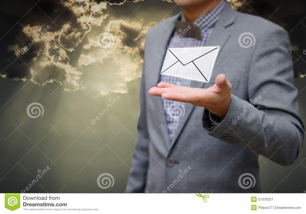 Businessman get email in hand with shiny sky