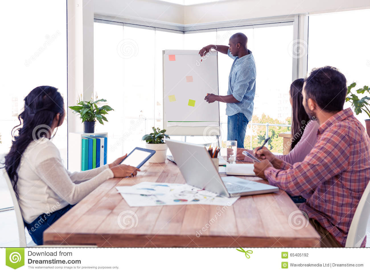 Businessman giving training to team in office