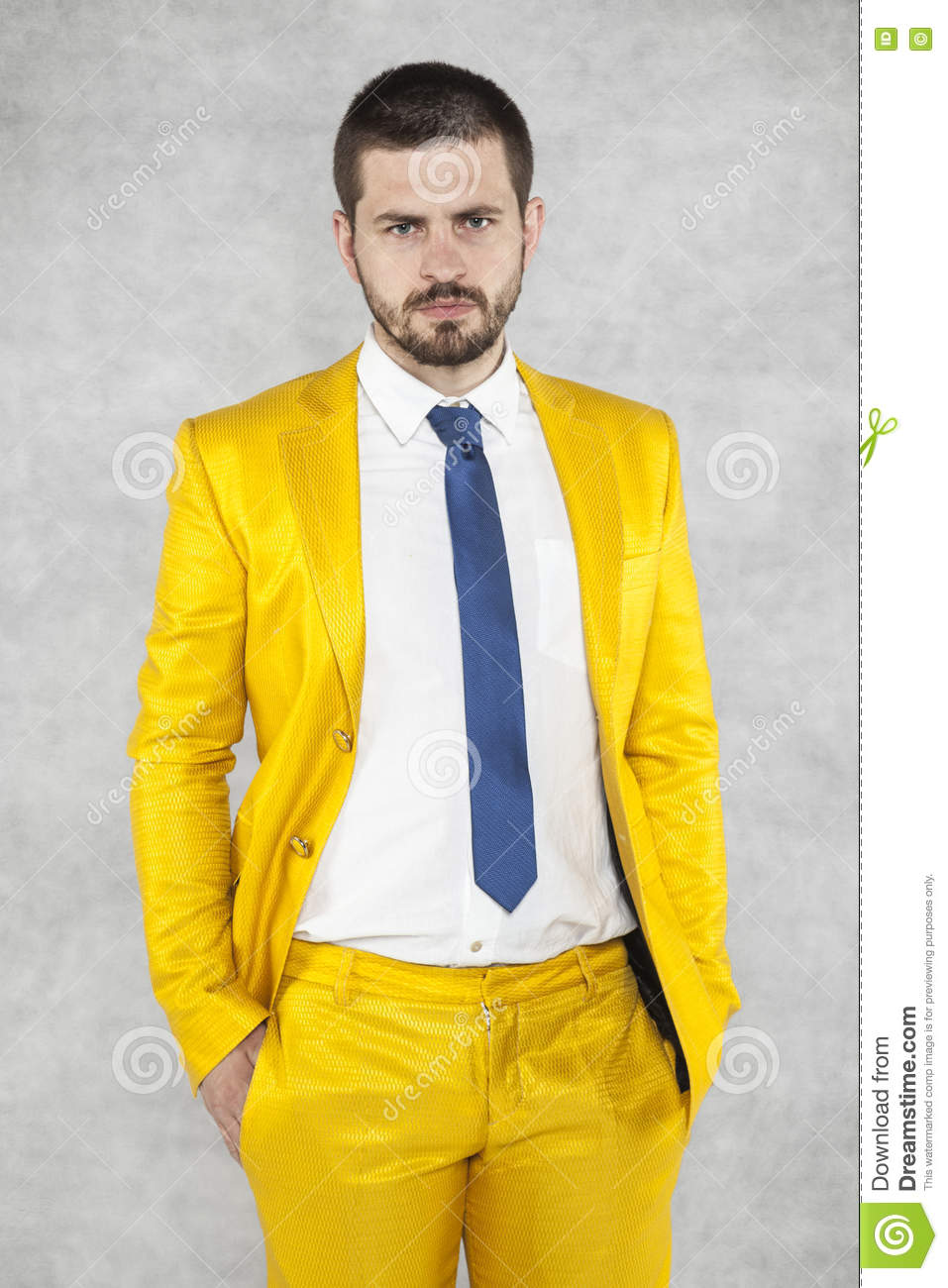 Businessman in a gold suit is very confident
