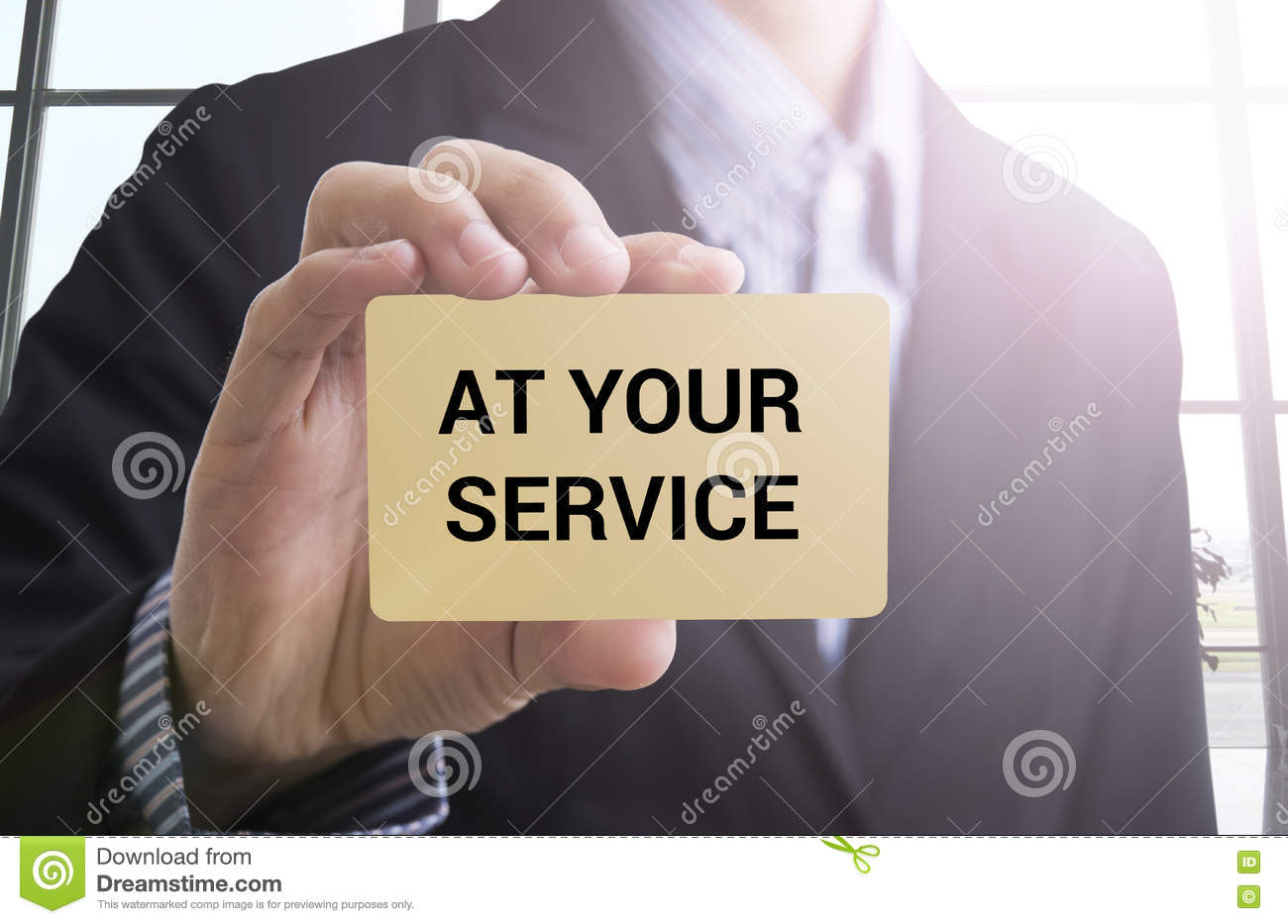businessman hand holding business card with message at your service