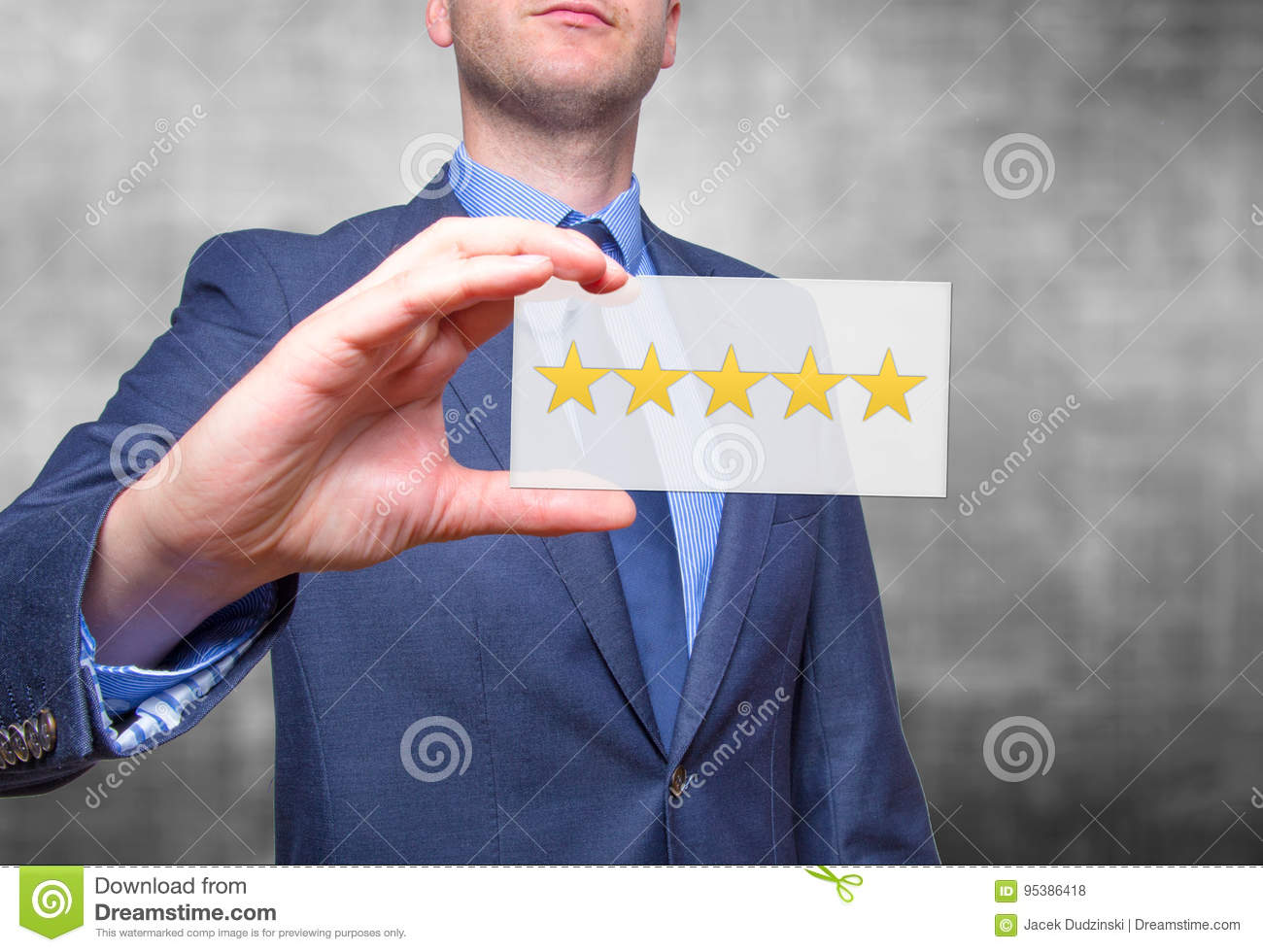 Businessman hand holding five stars isolated on grey background.