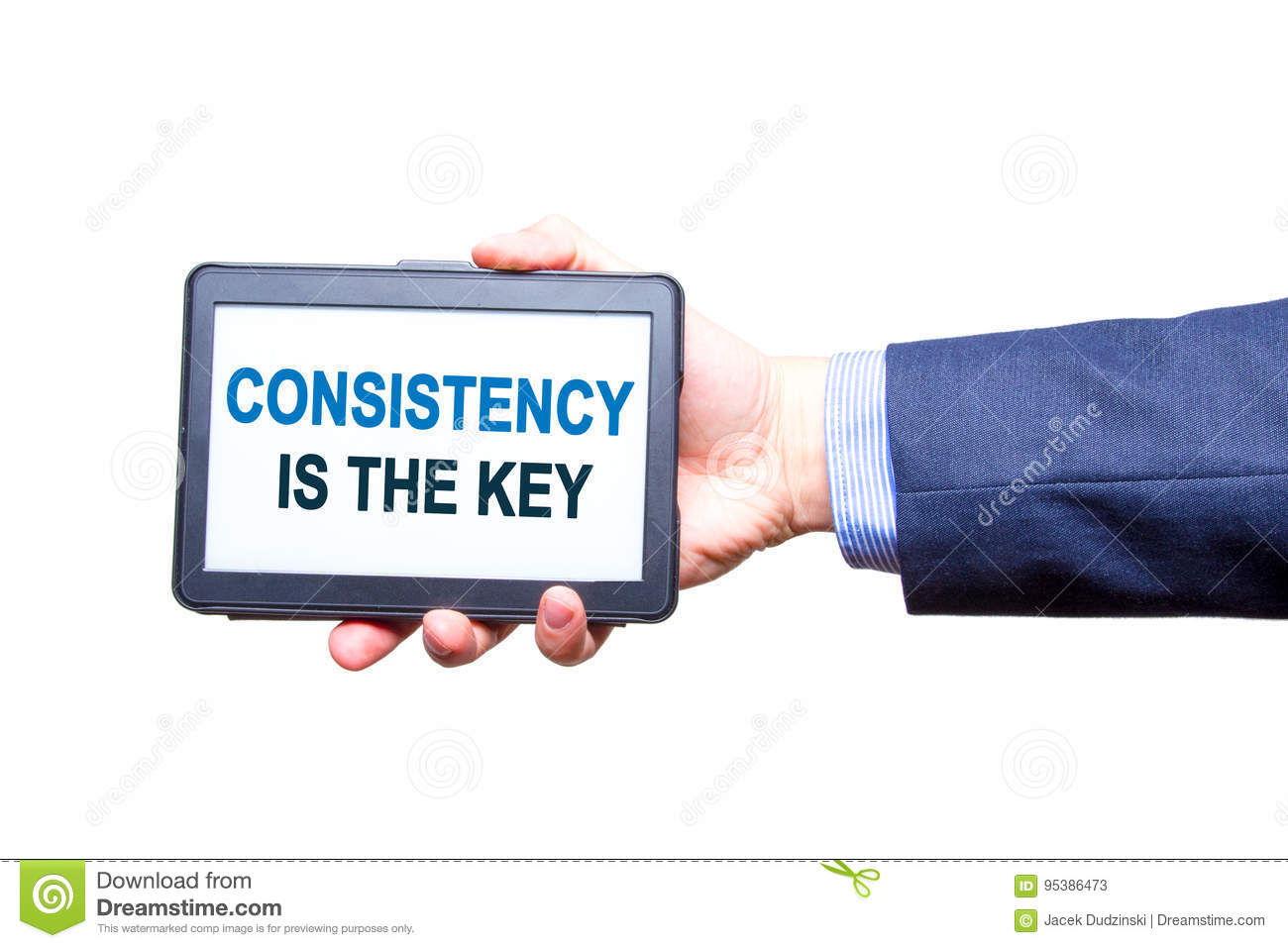 Businessman hand holding tablet with Consistency is The Key text