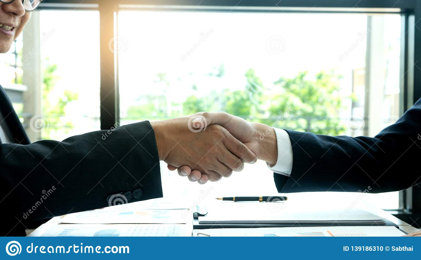 businessman hand shake with another business man