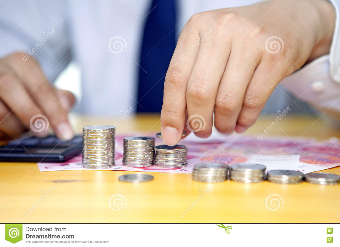 Businessman hand stacking coins