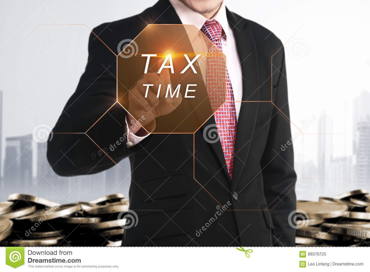 Businessman hand touching Tax Time button