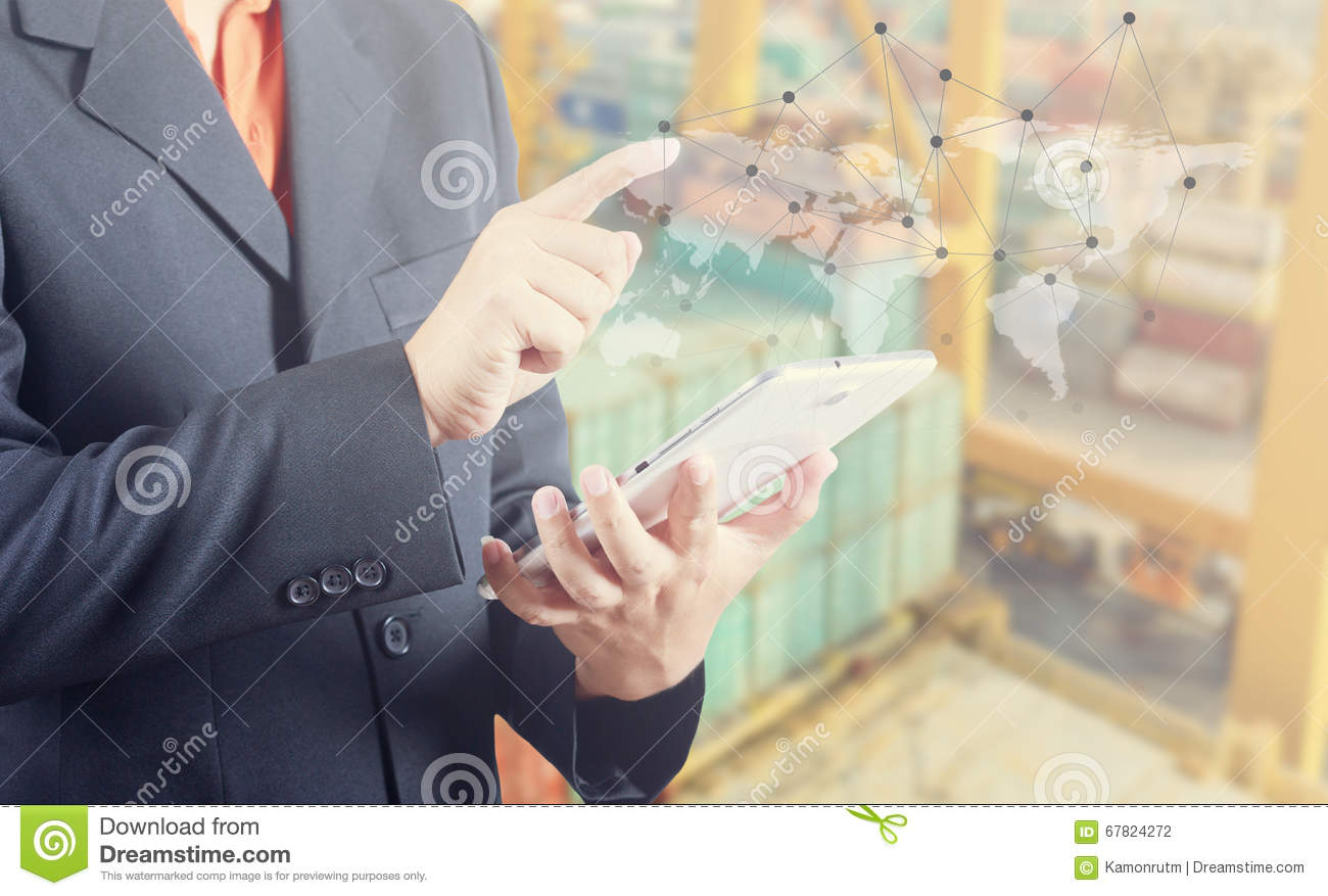Businessman hand working and smart phone and laptop on Industrial Container Cargo freight ship background (Elements of this image