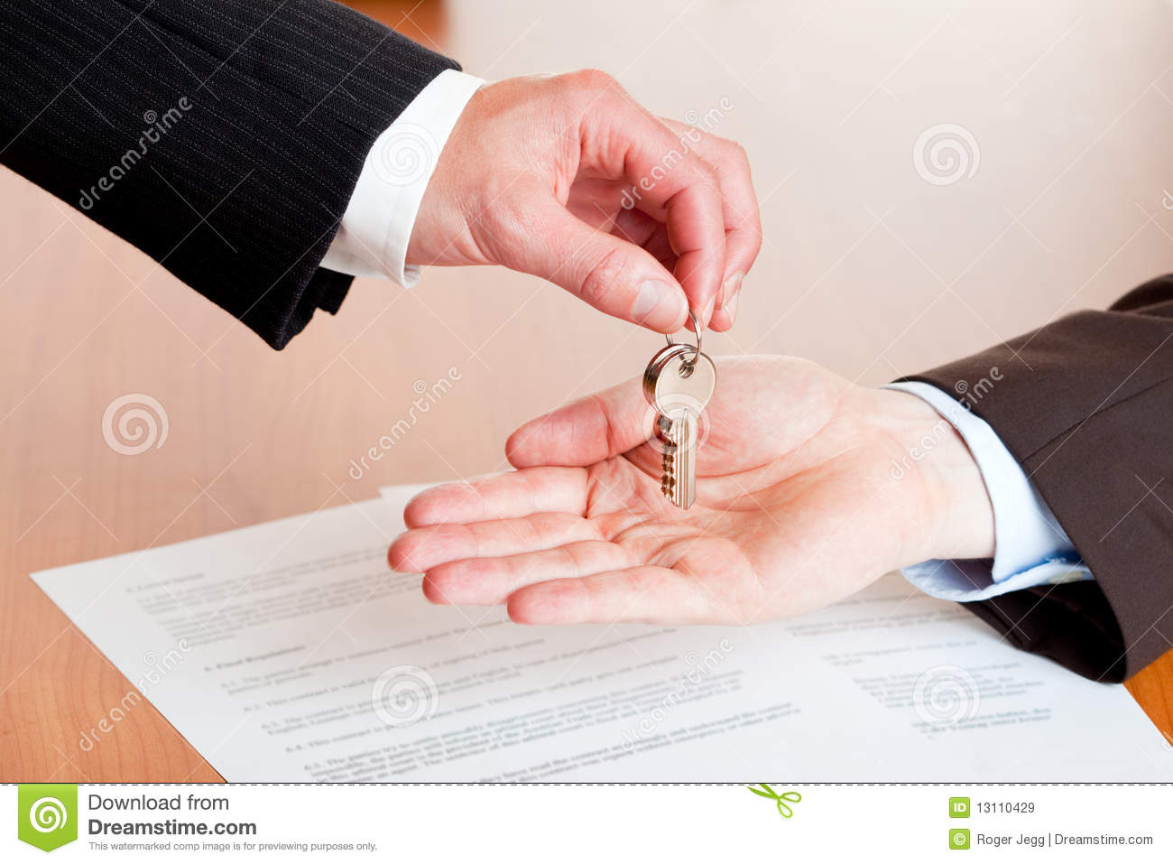Businessman handing over house or car keys royalty free for Casas llave en mano
