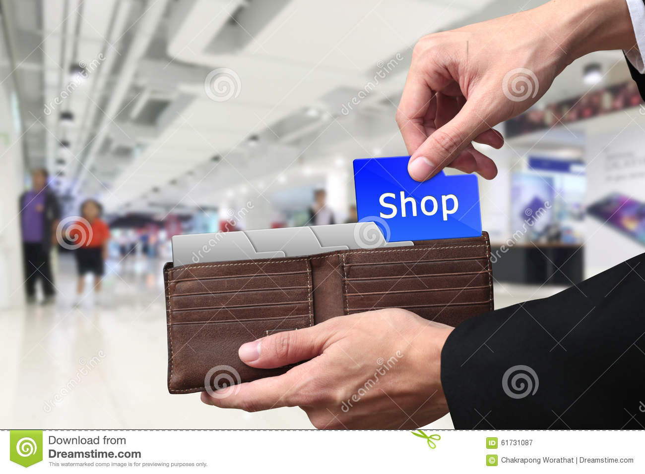 Businessman hands pulling money Shopping concept on brown wallet
