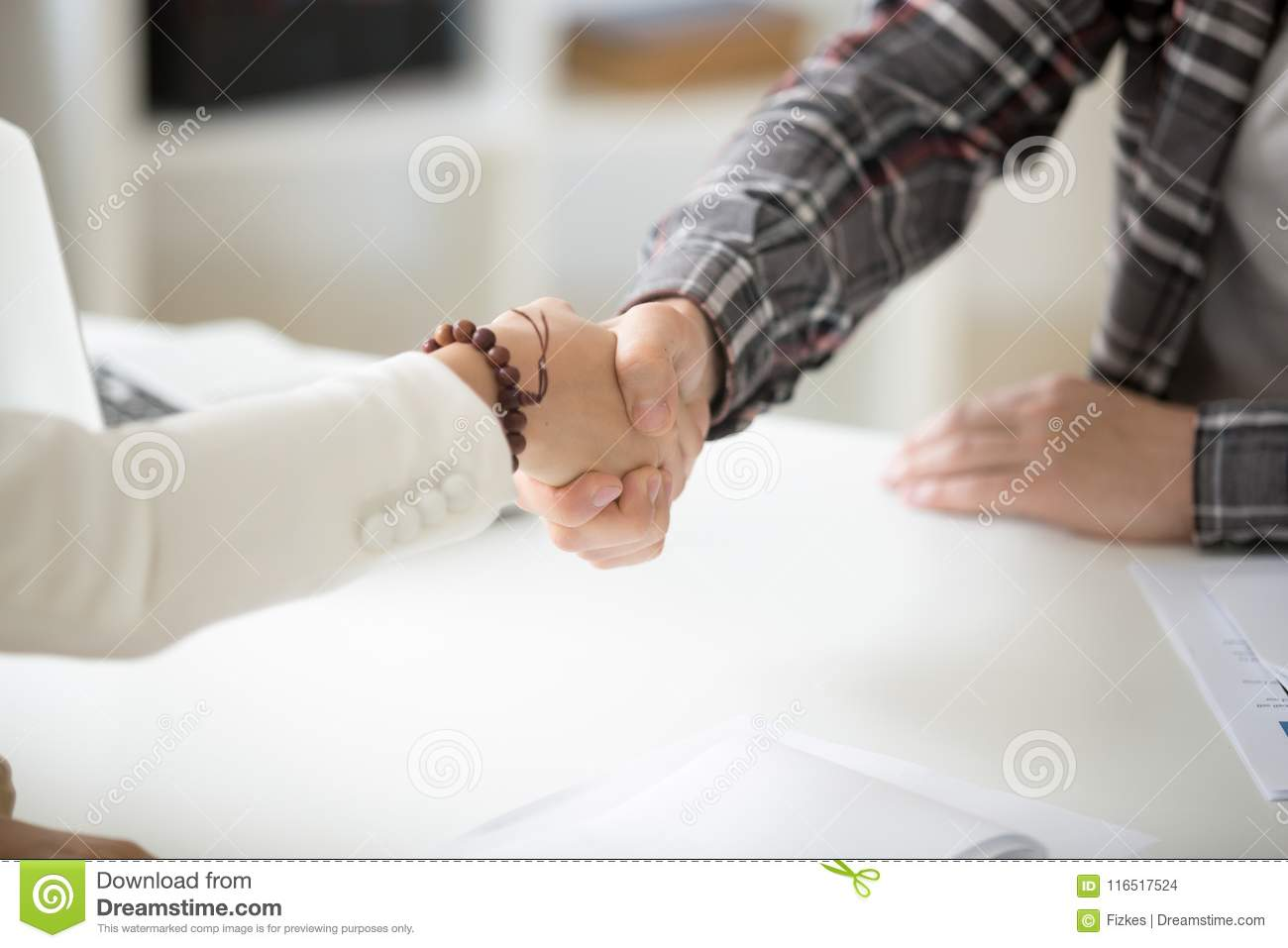 Businessman handshaking businesswoman making deal or showing res