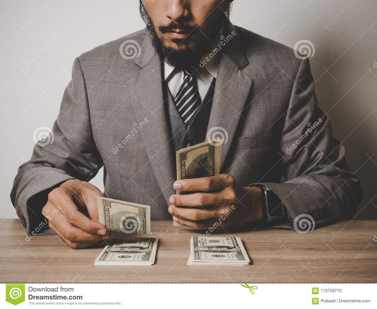Businessman happy with many dollar banknote, business success co