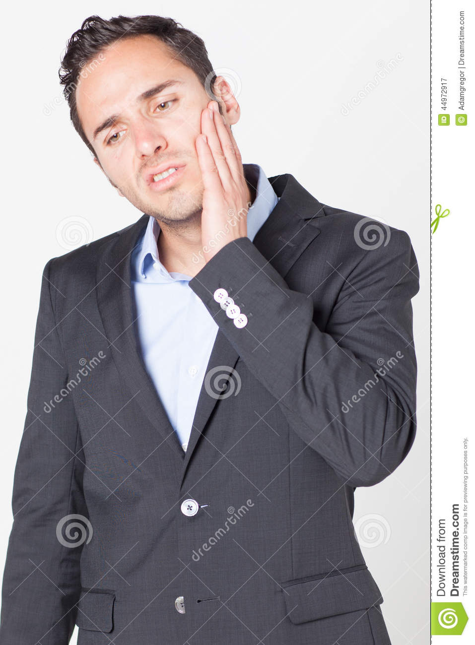 Businessman having toothache