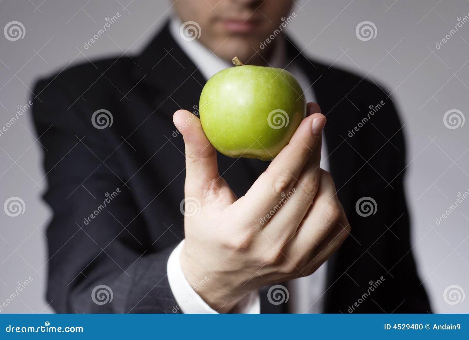 Businessman holding apple