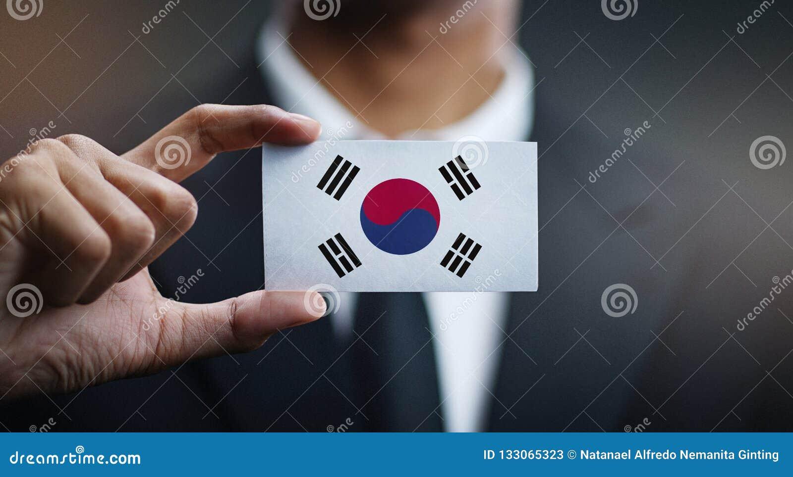 Businessman Holding Card of South Korea Flag