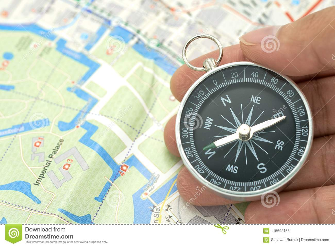 Businessman holding a compass with Japan map using as background travel concept with copy spaces and white space for your.