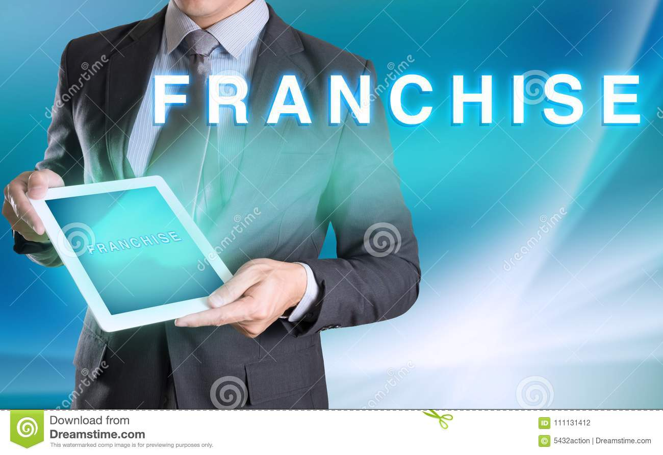 businessman holding computer tablet in hand and show FRANCHISE w
