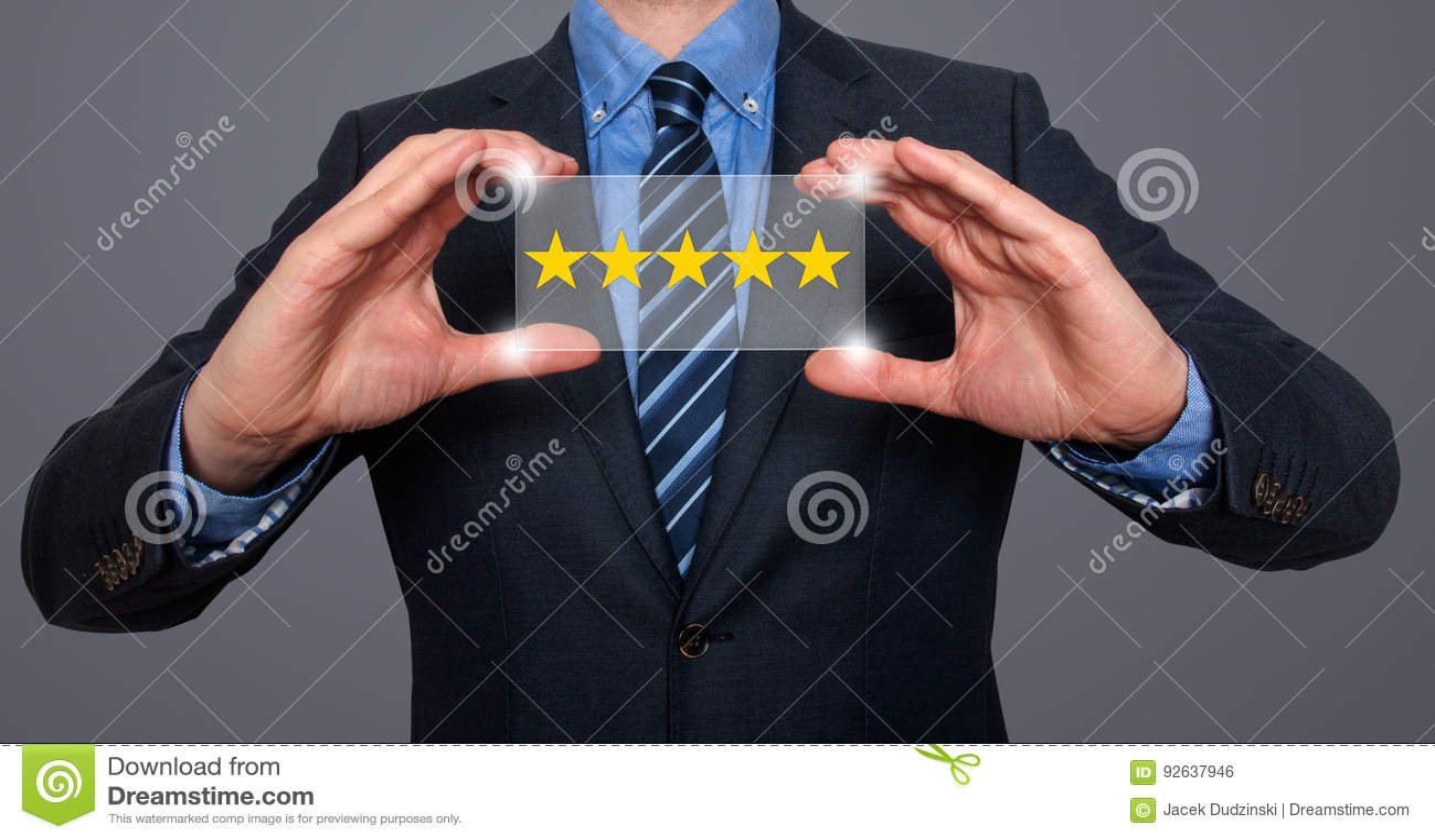 Businessman holding five star rating