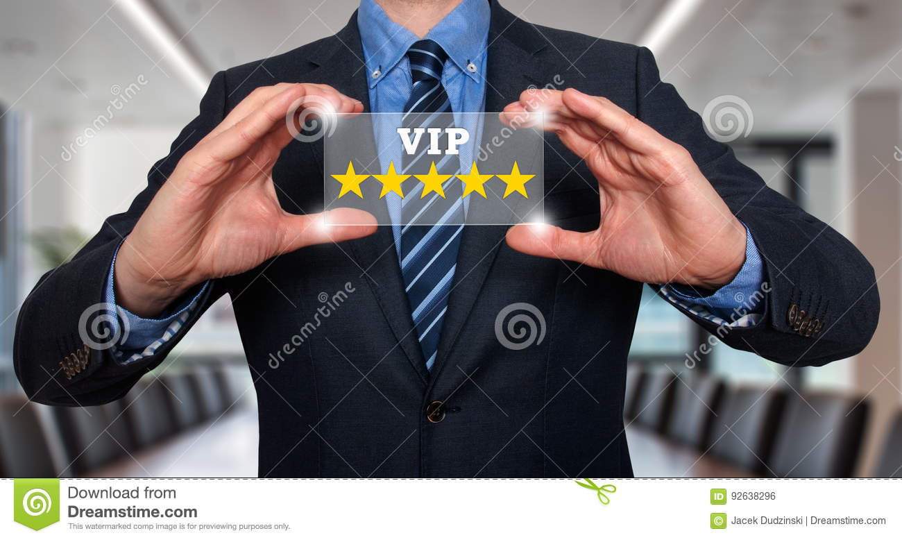 Businessman holding five star rating VIP - Office - Stock Image