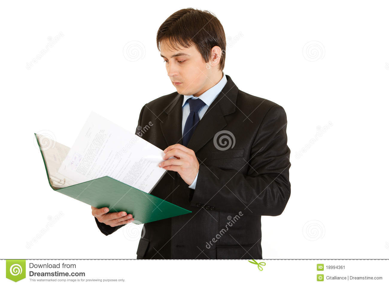 Businessman holding folder and checking documents