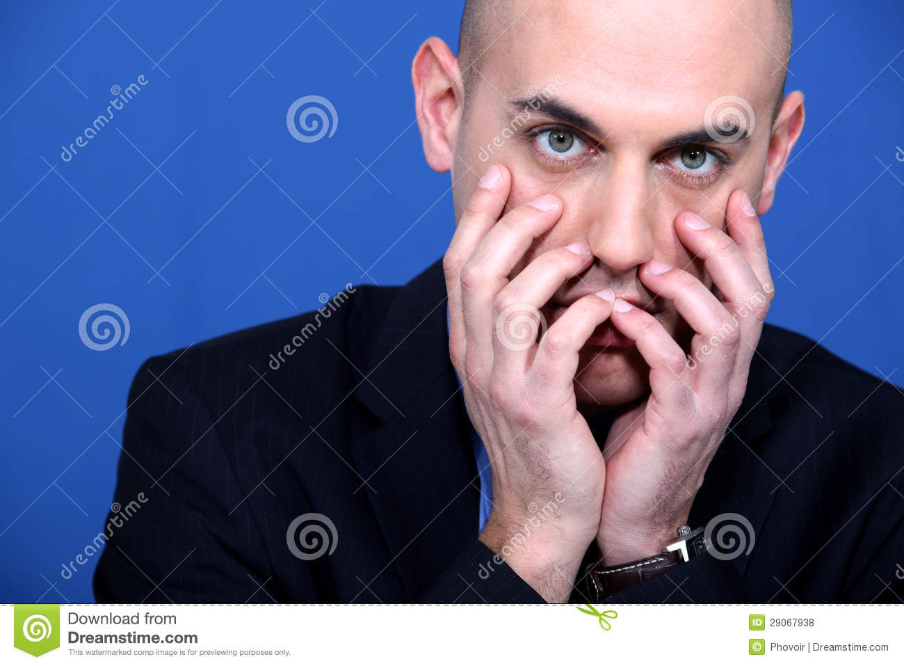 Technology Management Image: Businessman Holding Hands To Face Stock Photo